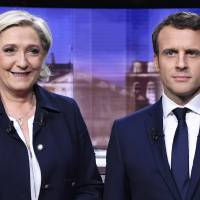 Le Pen and Macron trade insults on TV in heated final French debate