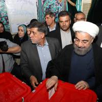 Iranian President Hassan Rouhani casts his ballot during the presidential election in Tehran on Friday.   REUTERS