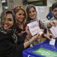Rouhani leads Iran presidential race, looks set for victory, source says