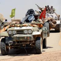 Iran-backed paramilitaries reach Iraq's border with Syria in push against Islamic State
