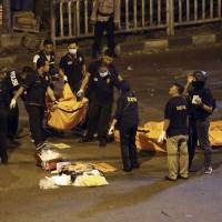 Two suicide bombers kill three police officers outside Jakarta bus terminal