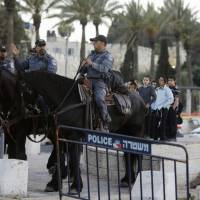 Palestinian girl, 16, shot dead trying to stab police at gate to Jerusalem's Old City