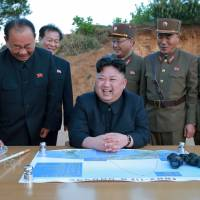 North Korean leader Kim Jong Un celebrates the test launch of the long-range strategic ballistic rocket Hwasong-12 with Ri Pyong Chol (second from left), Kim Jong Sik (center) and Jang Chang Ha (second from right) in this undated photo released by state media on May 15. | REUTERS