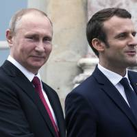 Macron stands ground with Putin, hits Russia media's 'lying propaganda'