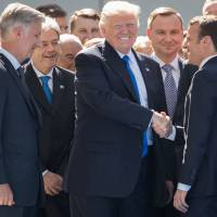 Don't make hasty decision to exit Paris climate pact, Macron urges Trump