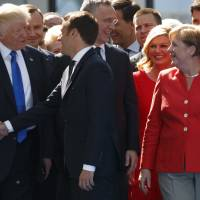 Macron says he was ready to out-Trump Trump in Brussels handshake