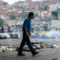 Venezuela's Maduro tries Chavez's constitution tack in bid to delay elections