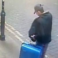 Manchester police seek clues over concert bomber's suitcase as U.K. arrests reach 14