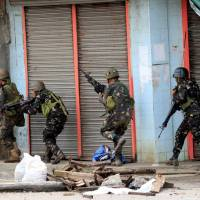 Philippine forces attack besieged city to clear Islamic State-linked rebels as deaths mount