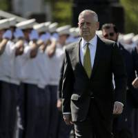 Secretary of Defense James Mattis walks into Michie Stadium to give the commencement address, Saturday in West Point, New York. | AP