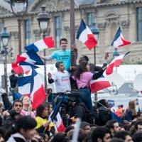World's media issue positive verdict on Macron win but also express caution