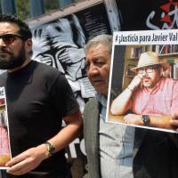Mexicans demand justice after brazen murder of prominent reporter, the fifth this year