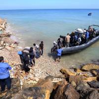 Dozens on sinking dinghy lost at sea, rescued migrants tell UNHCR