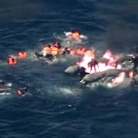 Dramatic video shows migrants rescued from burning dinghy