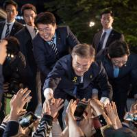 South Korea's new president says he is willing to visit rival North Korea