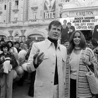 In this 1977 file photo, actor Roger Moore is accompanied by co-star Barbara Bach as they arrive for the screening of 'The Spy Who Loved Me,' during the Cannes Film Festival. The British actor, star of seven James Bond movies, died Tuesday after a battle with cancer, according to a statement from his family.  | AP