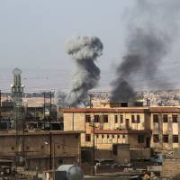Smoke billows in a neighborhood called 17 Tammuz following a car bomb explosion, west of Mosul, on Thursday during an ongoing offensive to retake the area from Islamic State (IS) group fighters. | AFP-JIJI