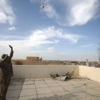 An Iraqi soldier gestures toward a drone west of Mosul, Iraq, Thursday during an ongoing offensive to retake the area from Islamic State (IS) group fighters. | AFP-JIJI