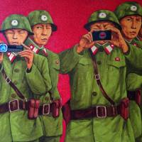 A painting by North Korean defector Song Byeok is displayed at his first U.K. exhibition in London on Tuesday. | EMMA BATHA / VIA THOMSON REUTERS FOUNDATION