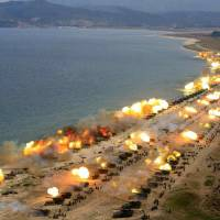 The North Korean military stages a massive artillery drill on April 25, the anniversary of the founding of the Korean People's Army, in this photo taken from the North's Rodong Sinmun newspaper.   KYODO