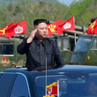 North Korean leader Kim Jong Un watches a military drill marking the 85th anniversary of the establishment of the Korean People's Army (KPA) at an undisclosed location in this photo released on April 26.   KCNA / VIA REUTERS