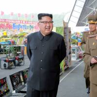 North Korean leader Kim Jong Un visits the exhibition of utensils and tools, finishing building materials and sci-tech achievements organized by the Ministry of the People's Armed Forces in this undated photo released Saturday. | KCNA/VIA REUTERS