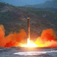 North Korea says new, longer-range missile can carry 'large' nuclear warhead