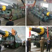 North Korean leader Kim Jong Un examines the country's new intermediate-range missile, referred to as the Hwasong-12, in this photo taken from the Monday edition of the North's official Rodong Sinmun daily. | KYODO