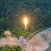 North Korea hails test of 'precision-guided' missile as success, vows bigger 'gift package' for U.S.