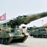 A new North Korean 'precision-guided' ballistic missile is displayed during an April military parade marking the 105th anniversary of the birth of founder Kim Il Sung.   KYODO