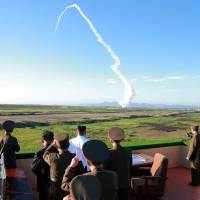 North Korean leader oversees test of 'new anti-aircraft weapon'