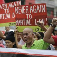 Duterte vows to ignore top court, Congress over martial law move in south