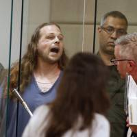 Jeremy Joseph Christian shouts as he is arraigned on Tuesday in Multnomah County Circuit Court in Portland, Oregon. | BETH NAKAMURA / THE OREGONIAN / VIA AP, POOL