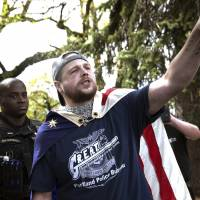 In an April 29 photo provided by John Rudoff, Jeremy Joseph Christian (right) is seen during a Patriot Prayer organized by a pro-Trump group in Portland, Oregon. | JOHN RUDOFF / VIA AP