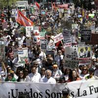 Rallies staged across U.S. for workers and immigrants, and against Trump