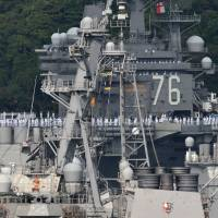 The USS Ronald Reagan aircraft carrier is moored at its home port in Yokosuka, Kanagawa Prefecture, on Monday. The vessel departed the naval base there Tuesday for a scheduled annual patrol of the Asia-Pacific region. | AFP-JIJI