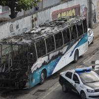 Rio police kill two suspected drug gang members amid retaliatory clashes, bus torchings