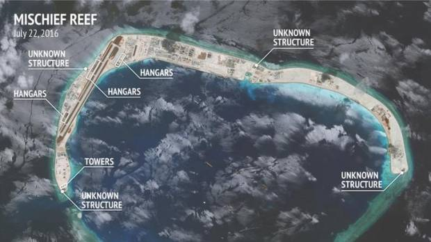 In first under Trump, U.S. warship sails near China-claimed man-made island in South China Sea
