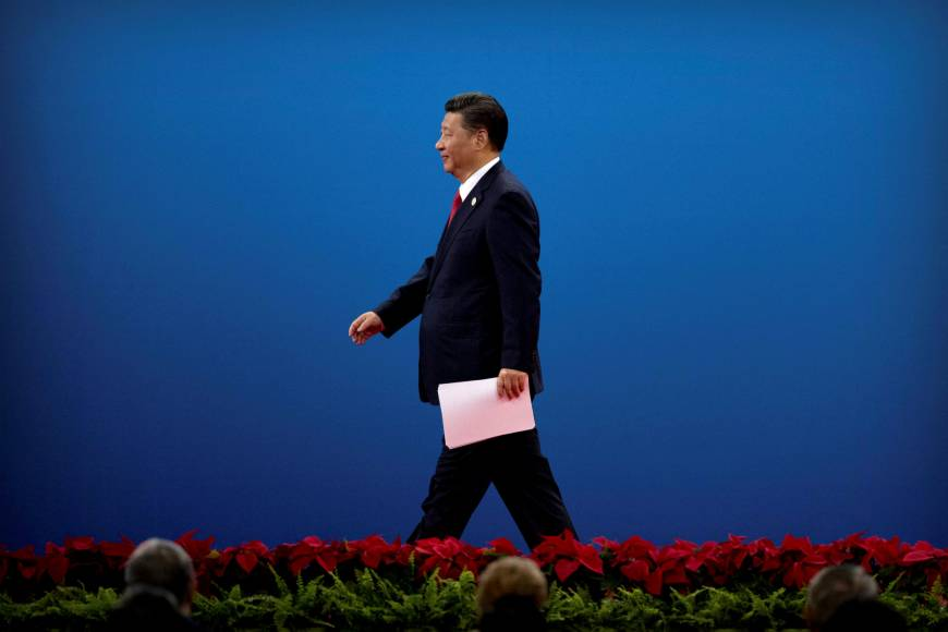 Chinese President Xi Jinping exits the stage after addressing the 'Belt and Road' globalization initiative in Beijing on Sunday. | REUTERS
