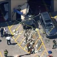 SUV suddenly takes off during auto auction, kills three before crashing into wall
