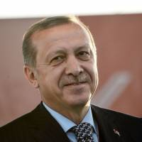 Turkish President Recep Tayyip Erdogan delivers a speech during Istanbul Youth Festival in Istanbul on Thursday. Erdogan said a Moscow-backed plan to set up so-called de-escalation zones inside Syria would '50 percent' solve the six-year conflict, in comments published Thursday. | AFP-JIJI