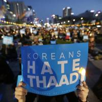 'Shocked' South Korea leader Moon orders probe into extra U.S. THAAD launchers