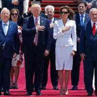 Trump greeted with selfies, abrupt politics on arrival in Tel Aviv