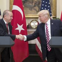 Trump hails ties with Erdogan, skips mention of U.S. arming of Kurds in Syria