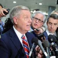 Sen. Lindsey Graham speaks to the media after Deputy U.S. Attorney General Rod Rosenstein's classified briefing for the full U.S. Senate on President Donald Trump's firing of FBI Director James Comey, in Washington Thursday. | REUTERS