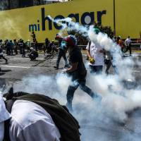 Venezuela activists alarmed as hundreds of civilian protesters go before military tribunals