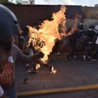 Maduro blames woes on Trump 'conspiracy' as Venezuela protest toll rises to 48 dead