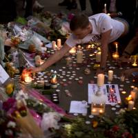 Manchester shows its grit in defiant vigil for attack victims