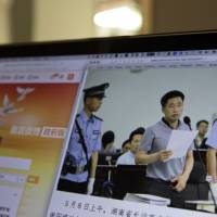 Chinese court says prominent rights lawyer admits to crimes