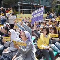 Protesters call for the abolishment of the 2015 accord signed by Tokyo and Seoul to resolve the wartime 'comfort women' issue, at a rally May 10 in front of the Japanese Embassy in Seoul. | KYODO